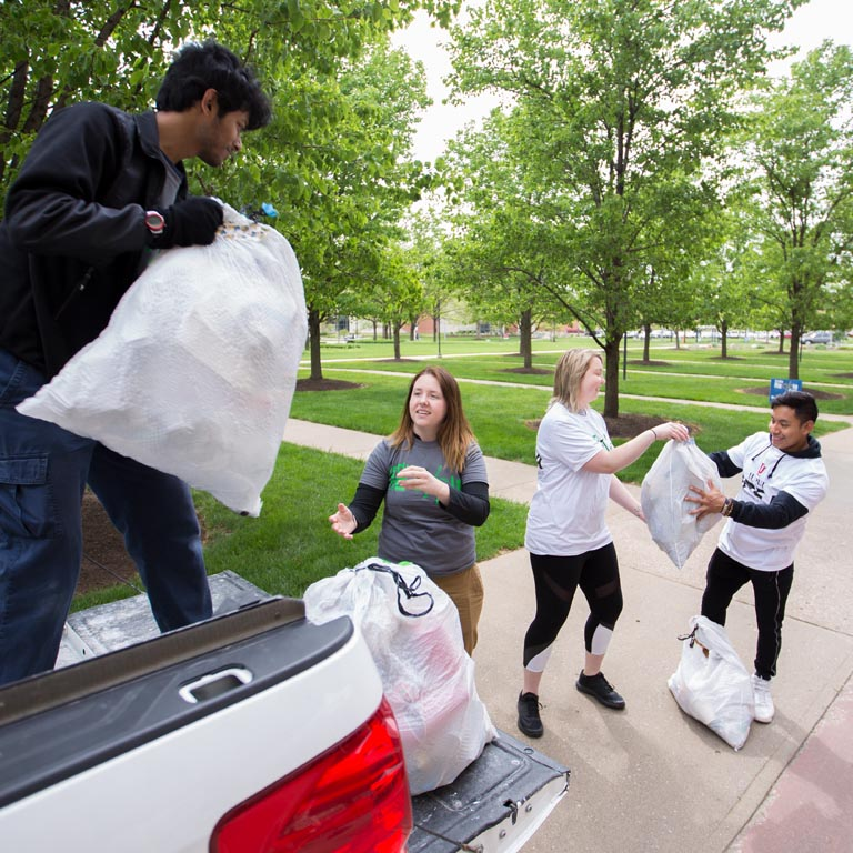 SPEA student volunteers collect trash.
