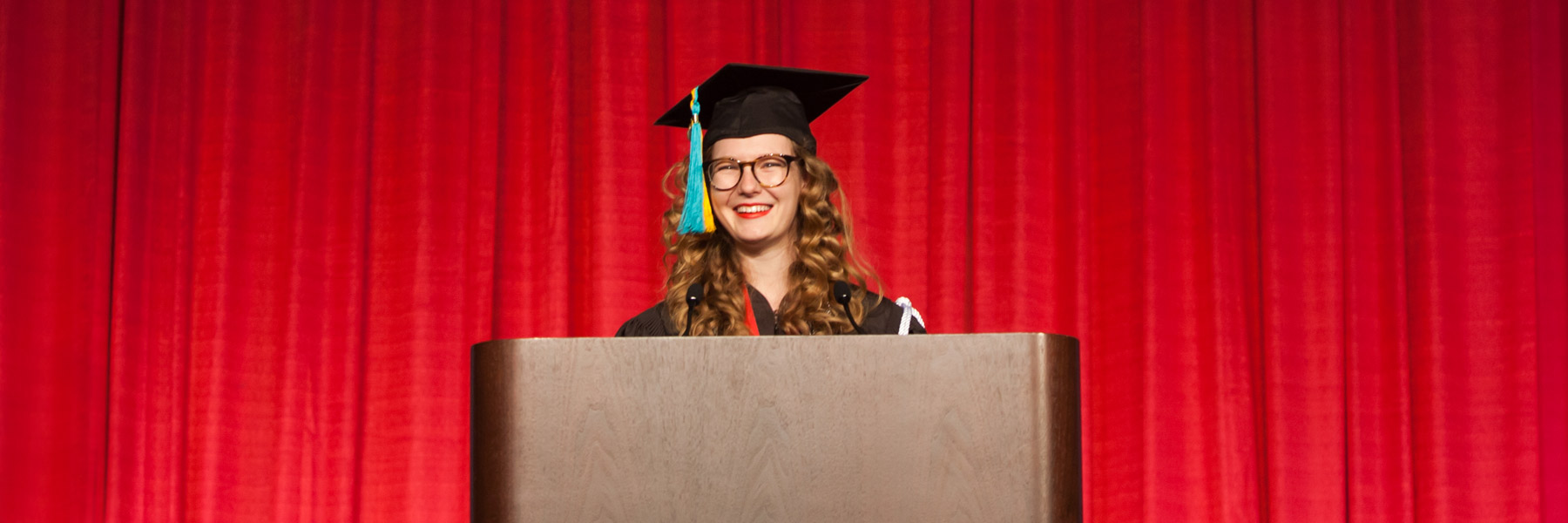 An honors student addresses the commencement audience.