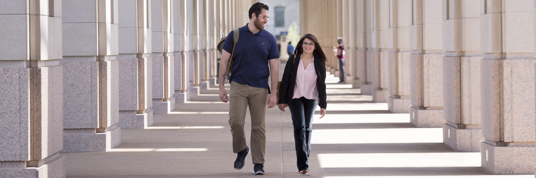 Two grad students walk together from the Indiana statehouse.