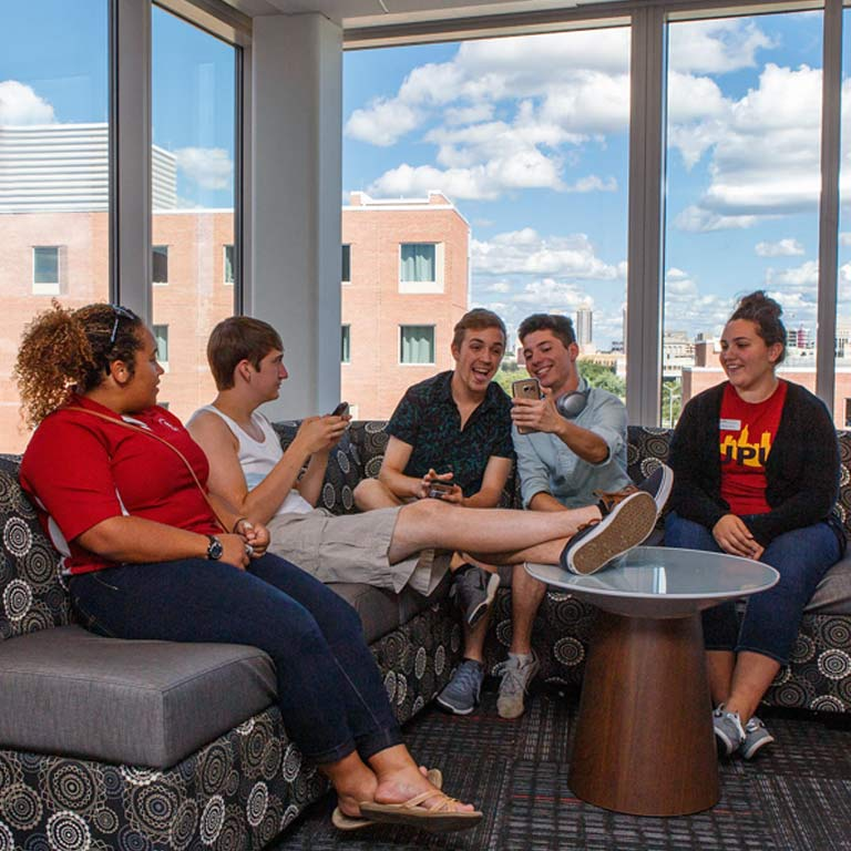 First-year students socialize in their new housing.