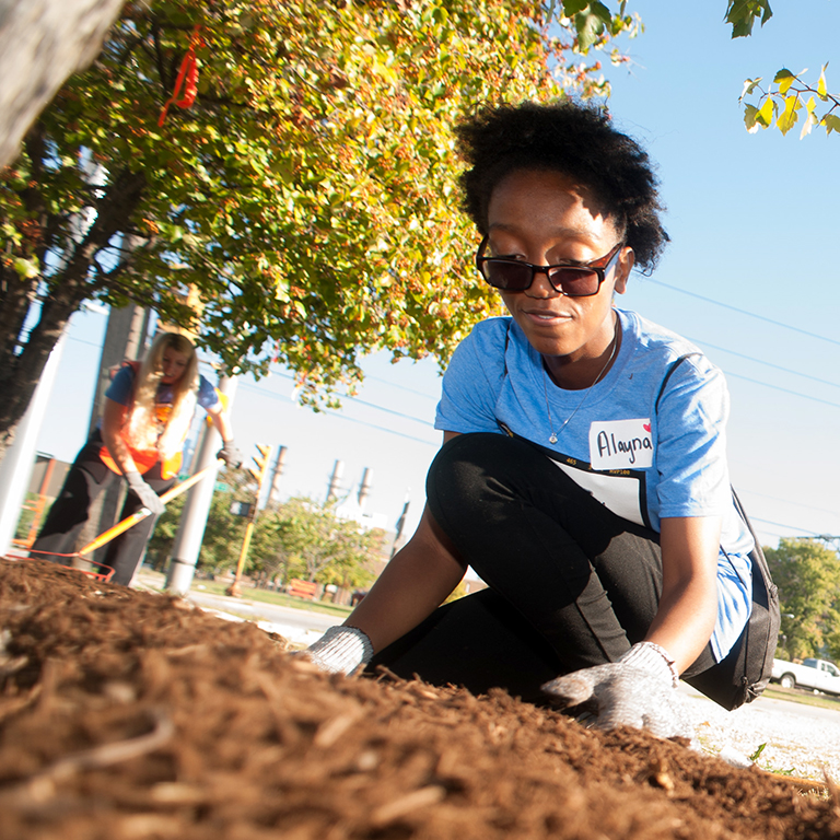 SPEA students work in a city garden.